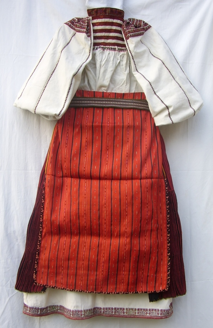 folk costume from Banat, linen shirt and skirt with geometrical motives, cotton apron and wool pleated apron.