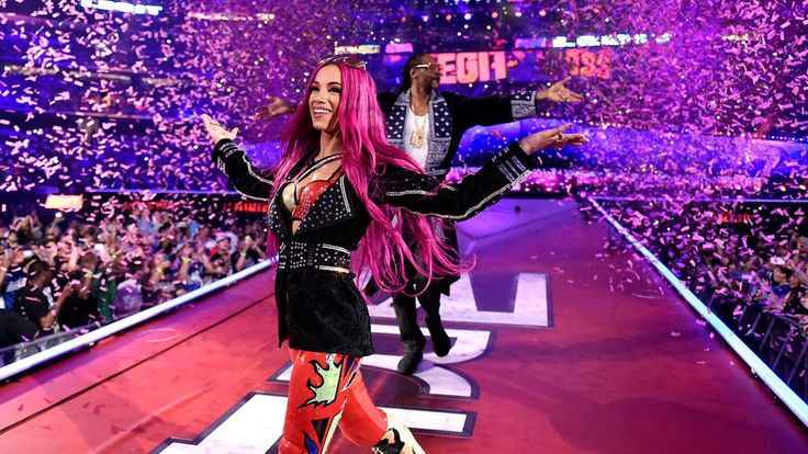Sasha Banks is escorted to the ring by her cousin, Snoop Dogg.