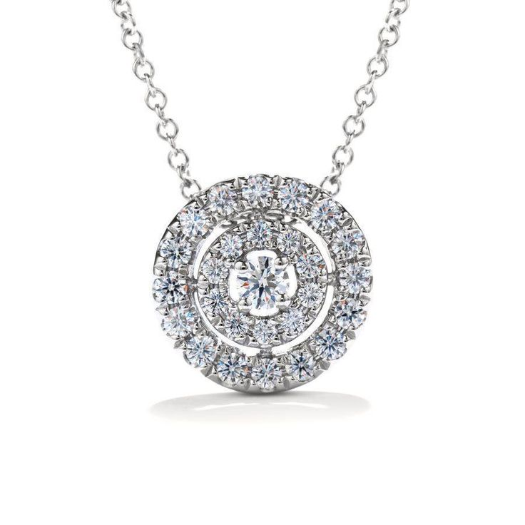 Concentric circles of sparkling Hearts On Fire diamonds surround a Hearts On Fire center diamond, creating an elegant and wearable pendant for all occasions...