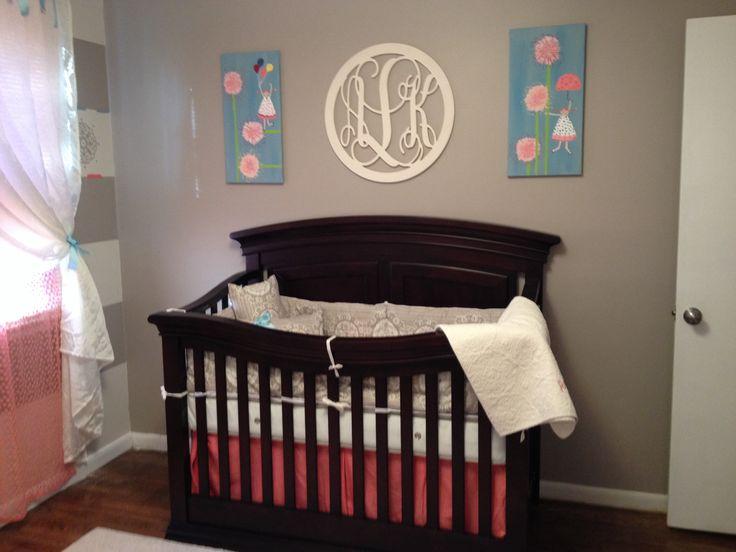 Monogram over crib.