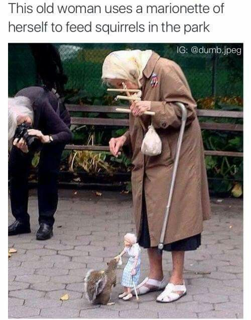 Woman uses a marionette of herself to feed squirrels