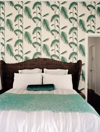 Green throw and tropical chic wallpaper, rattan bed head. Beautiful, coastal style by Shannon Fricke. www.shannonfricke.com