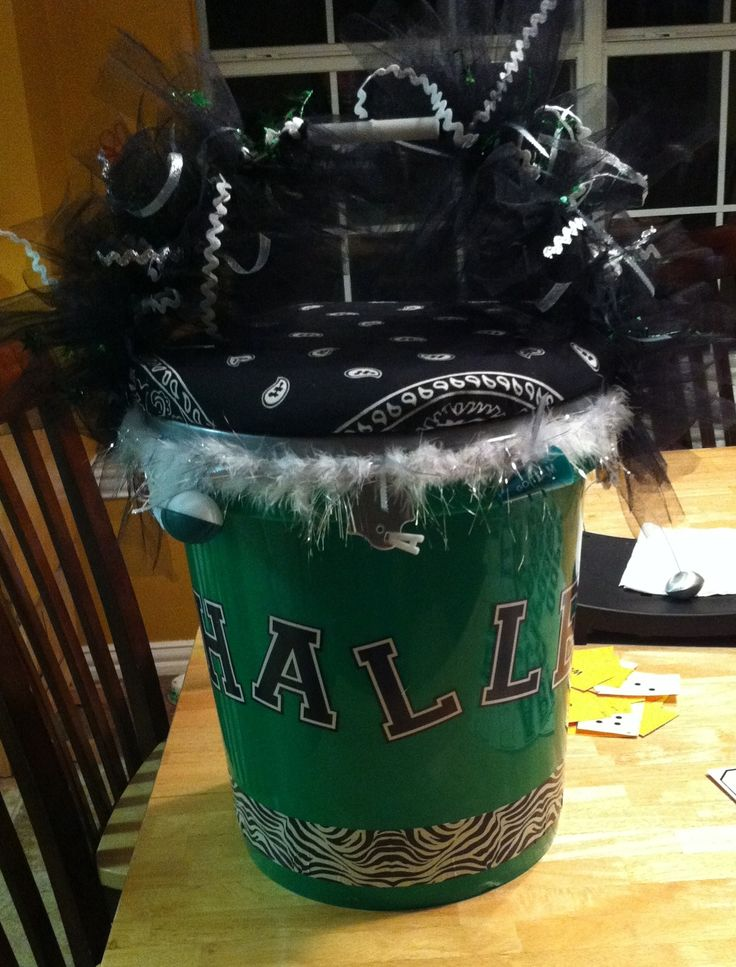 A cheer bucket! Can be used to hold poms, water or a snack...and can be used as a stool too.
