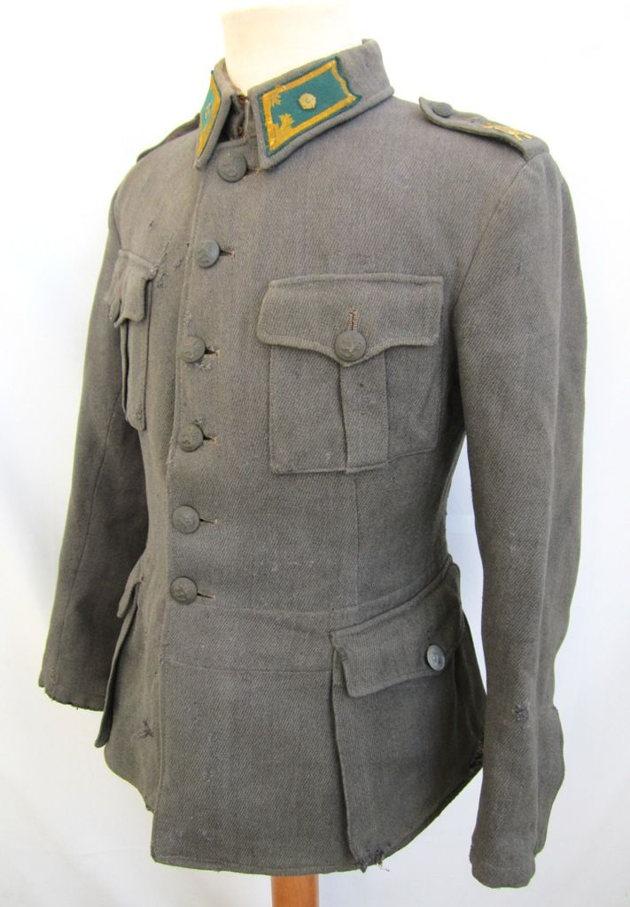 Jäger troops officer. Grey cabardine cloth. Green/yellow Jägertroops collartabs with 2nd lieutenant rank rosettes. Green-grey bakelite buttons. Stamped  50 B. Shoulderboard with Jäger - troop insignia.