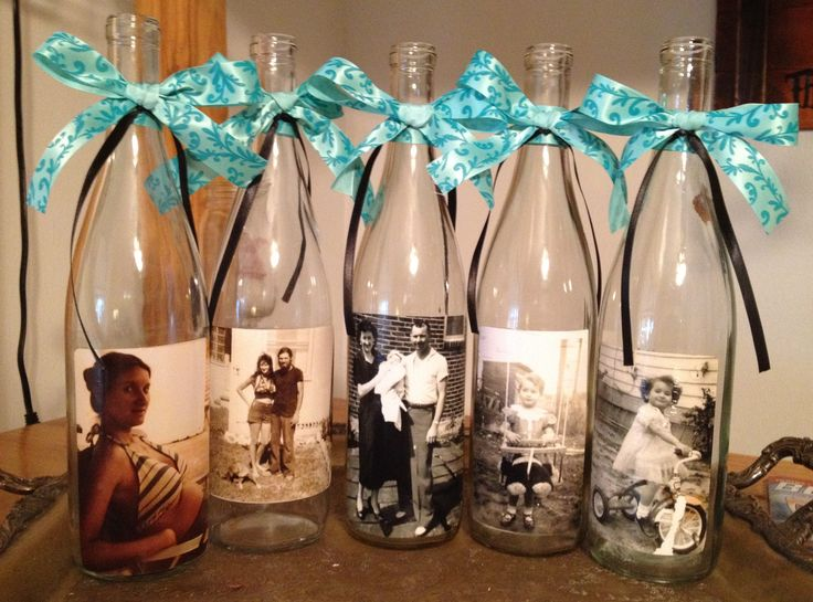 Mod Podge photos on wine bottles for center pieces. But I would put sand in bottom Tea Light behind... And different ribbon :-)