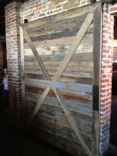 This is our face planed grey/brown barn board used as wall cladding in the View House here in Denver…   http://viewhouseco.com/