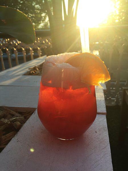 'Raspberry amaretto sour' with amaretto, raspberry liquer, lemon juice and fresh raspberries.