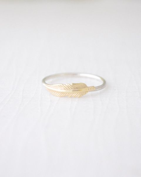 This dainty handmade Feather Ring matches your gold and silver jewelry perfectly. By Olive Yew.