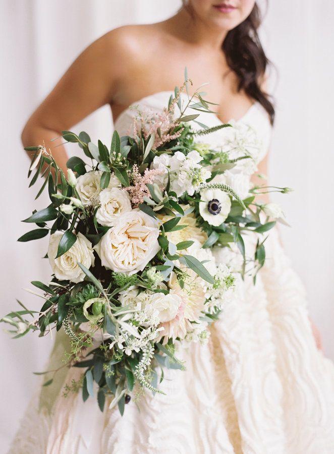 Cascading anemone, greenery and garden rose wedding bouquet: http://www.stylemepretty.com/little-black-book-blog/2017/02/16/romantic-baltimore-wedding-turkish-rug/ Photography: Michael and Carina - http://www.michaelandcarina.com/