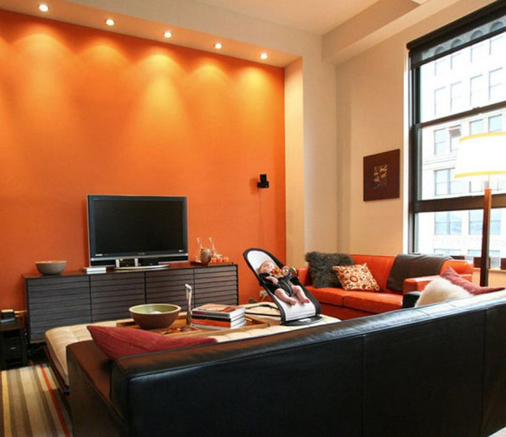 Orange Accent Wall And A Baby