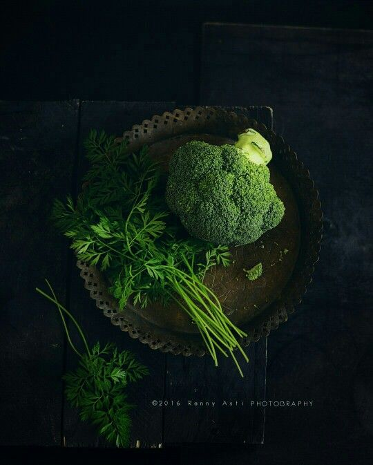 Broccoli and Cilantro. Lo-key photograph. Love how the vibrant green pops from the dark background.