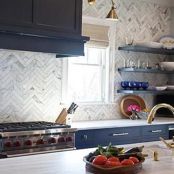 Navy Blue Kitchen Cabinets With Brass Bar Pulls And Marble Chevron Backsplash