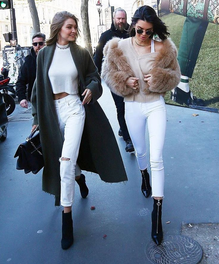 Kendall Jenner and Gigi Hadid are a stylish pair while out together in Paris wearing #Versaceaccessories. Kendall wears the Versace Zip-Up Ankle Bootie while Gigi carries her DV1 Bag in black. #VersaceCelebrities