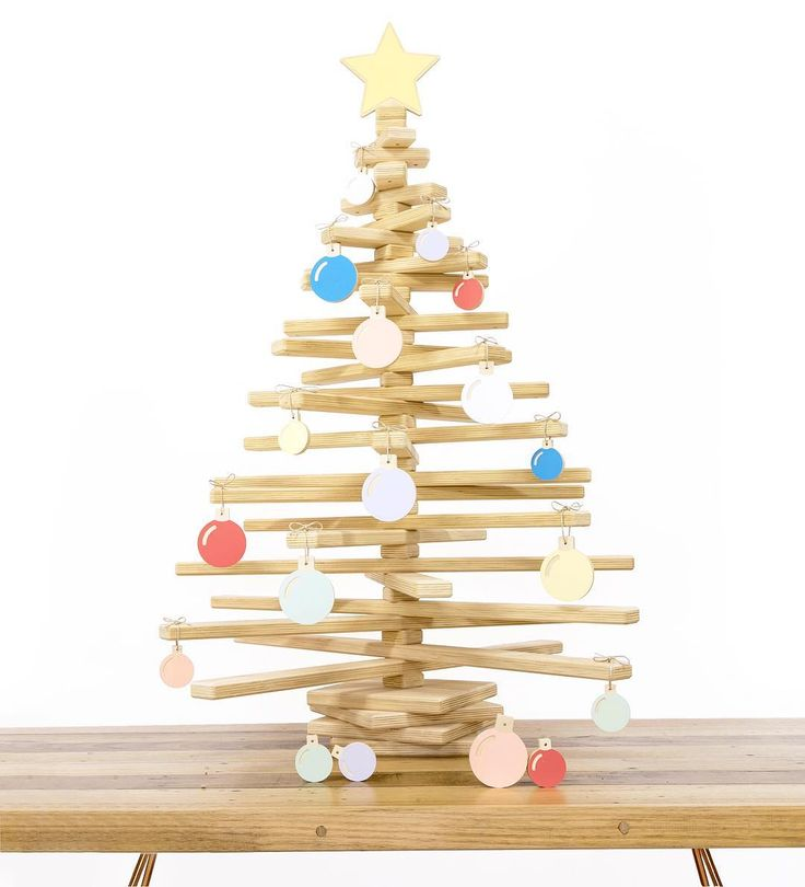 Dress your wooden Christmas Tree up with our range of hanging baubles!
