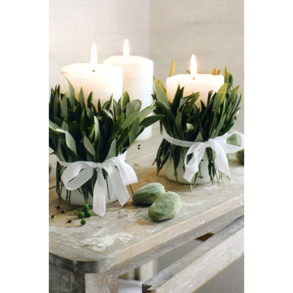 Anne, what about three thick candles and olive leaves tied with raffia on each table.  Want to find that fruit; whatever could it be?  To match wedding cake with olive branches