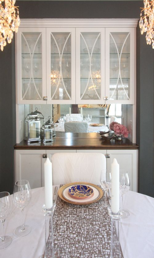 {Bria Hammel Interiors}  Gray dining room, white built in cabinet, gold chandeliers, champagne pink drapes