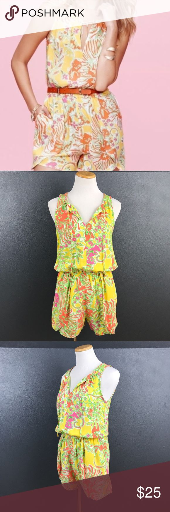 """Lilly Pulitzer for Target Romper Lilly Pulitzer for Target Romper. Tie front detail. Keyhole back with button closure. Elastic waist. Pockets. Rayon.Size XS. Fits more like a small. In great condition. A16  Underarm to underarm 17"""" Inseam 3"""" Total length 32"""" Lilly Pulitzer for Target Pants Jumpsuits & Rompers"""