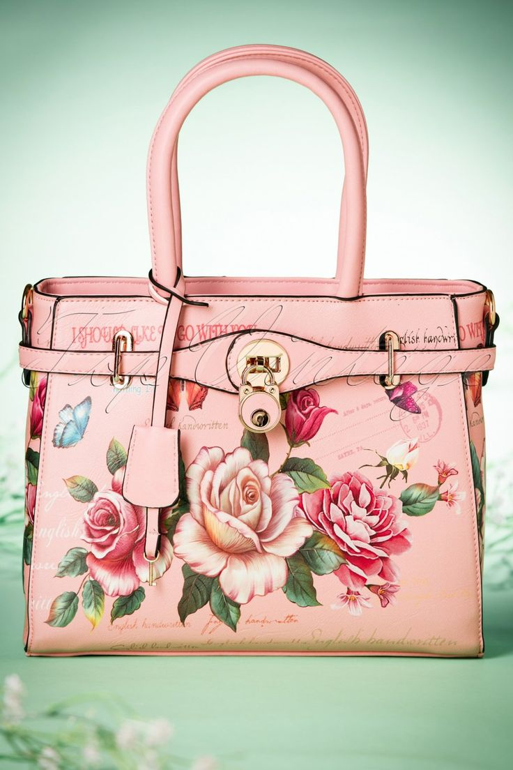 """The 50s Abigail Flowers Handbagis simply irresistible and a real must-have for every flower loving lady!  What's even better than a bouquet of flowers? A purse with the most stunning flower print you've ever seen! Made fromhigh quality pink faux leather featuring beautiful roses, fluttering butterflies and romantic quotes. Spring is just around the corner, we can't think of a better reason to buy a new """"spring"""" bag ;-)   ..."""