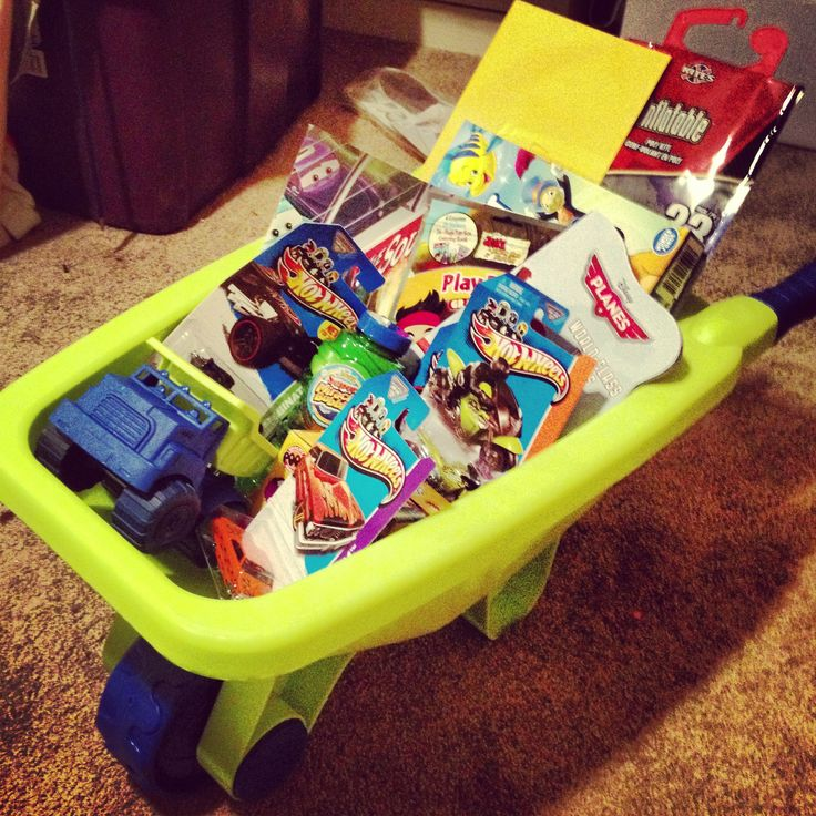 A cute gift for a 3-4 yr old! Get a plastic wheelbarrow or bucket and fill it with things the child will love. I put hot wheels, a game, books, bubbles, chalk, coloring books, a kite, & a toy truck.
