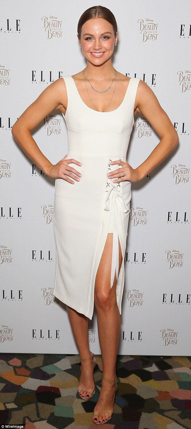 Body shock: Posing for pictures at the exclusive event, the 27-year-old flaunted her trim pins in a figure-hugging dress