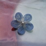 French beaded flower hair clip.