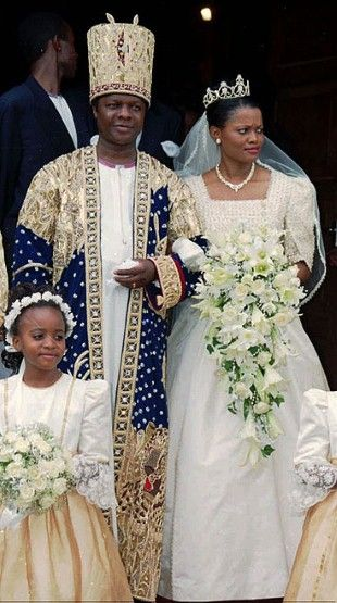 The leader of Uganda's Baganda tribe, King Kabaka Ronald Muwenda Mutebi, and his wife Queen Sylvier Nagginda at their wedding at a Cathedral near Kampala, Uganda, on August 27, 1999.