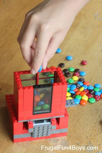 Have your kiddos build a Lego Candy Dispenser! WHAT FUN!!!