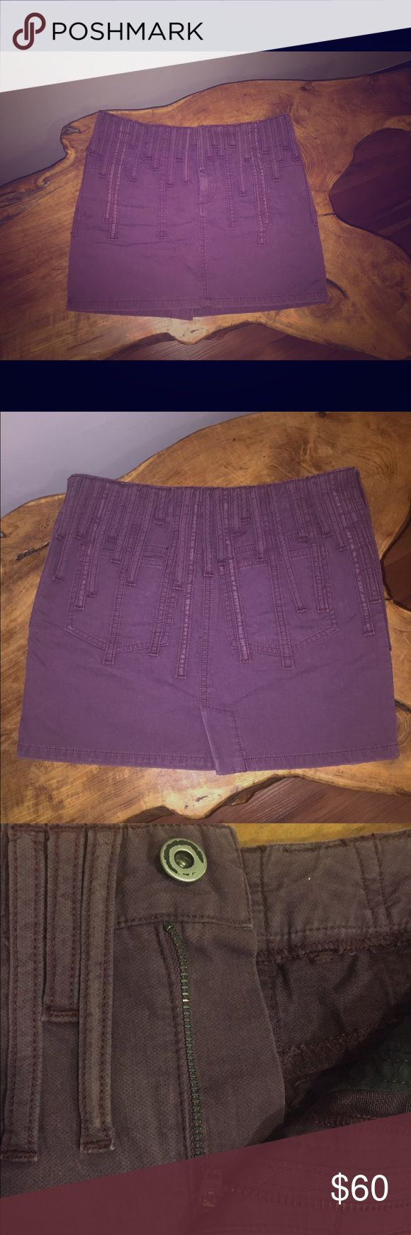 "Diesel Style Lab 80's rock denim statement skirt Festival chic, designer grunge, fitted denim mini from Diesel Style Lab in NYC that ran me hundreds of dollars, but to my disappointment never got the chance to wear because bending over was an issue.  Purplish plum color. I should have paired it with black leggings.  15"" length, 14.5"" across the top laid flat, small slit in back center.  Detailed random sized loops all around skirt, giving it a total over-all edgy look. 100% cotton. Made in…"