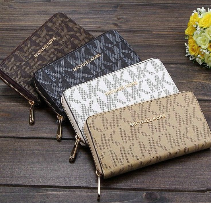 Michael Kors Coin Purse Like New Michael Kors Coin Purse...Zipper in working condition...Excellent condition of purse No Tarish of emblem....Used once Authentic No Trades Please! Michael Kors Bags