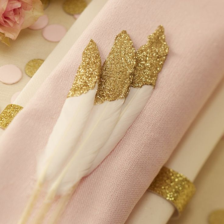 These gold glitter dipped feathers make very pretty table decorations for the big day. They add a touch of sparkle and look beautiful with a pastel theme - Pastel Perfection at GingerRay.co.uk