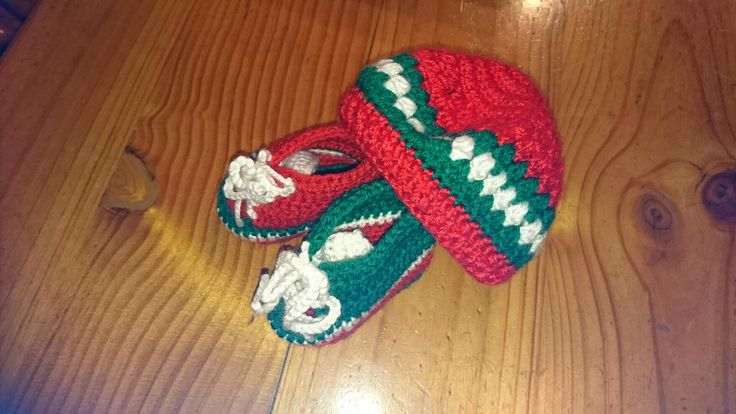 Crochet baby boots and cap for the future fan