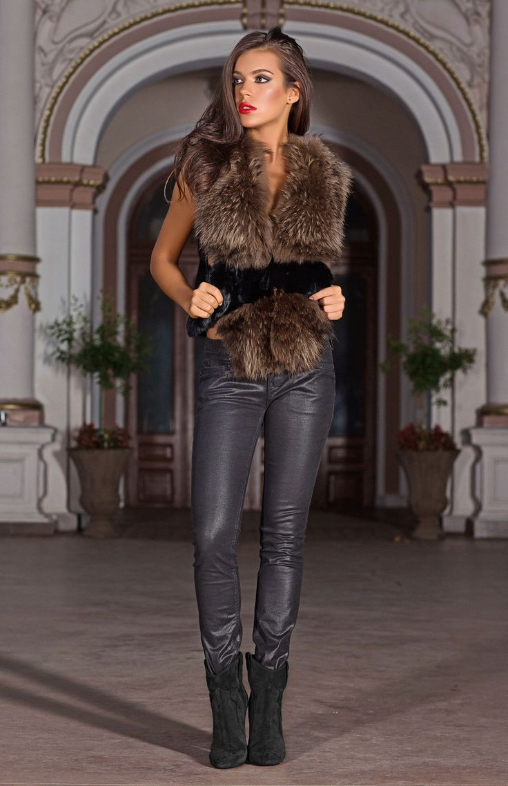 A trimmed cosy overcoat with long chocolate brown fur panels makes an on-trend addition to any winter wardrobe. The versatile Celestine gilet can be dressed up or down to create a number of stylish catwalk-ready looks.