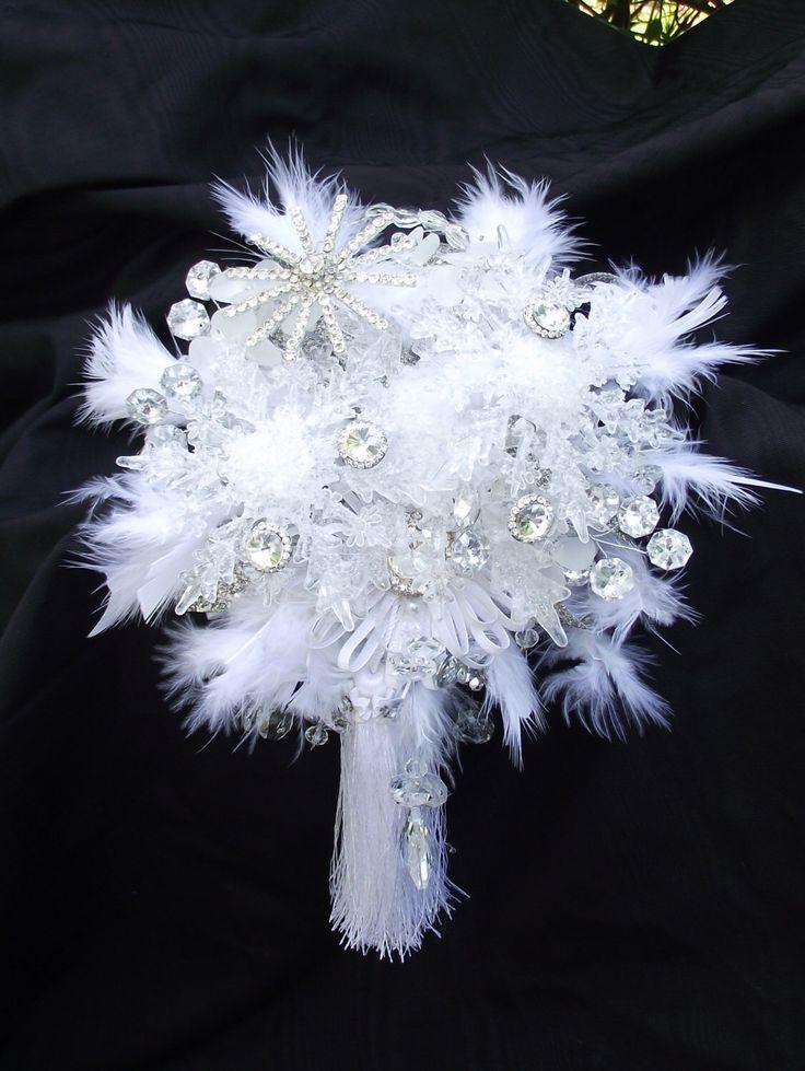 Winter wedding bouquet, snowflake bouquet, winter bridal bouquet, winter bouquet, Christmas wedding, tassel bouquet, feather wedding bouquet by UptownGirlzz on Etsy https://www.etsy.com/listing/166529048/winter-wedding-bouquet-snowflake-bouquet