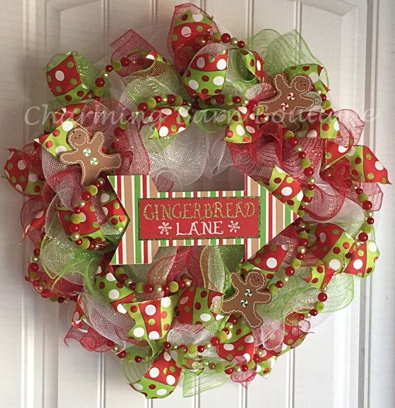 This fun and cute gingerbread lane Christmas wreath is the perfect thing to decorate your door for the holidays. Made with deco mesh and