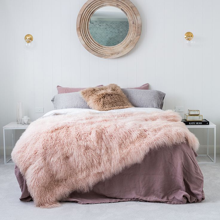 Hides of Excellence pink blush Mongolian sheepskin blanket 120cm x 180cm is a soft & luxurious to drape over the bed or lounge.