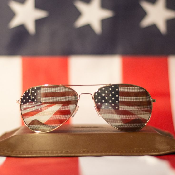 The Top Gun Flag Aviators -     Tom Cruise wouldn't even mess with you while you rock these iconic Aviators.  Put on these shades and the next thing you know you will be spiking volleyballs, flying fighter jets, and partying like it's 1989.  What are you waiting for?  Cruise off into the sunset with The Top Gun Flag Aviators.      Specs: UV Protection and Polarized     www.AmericaPartyGear.com