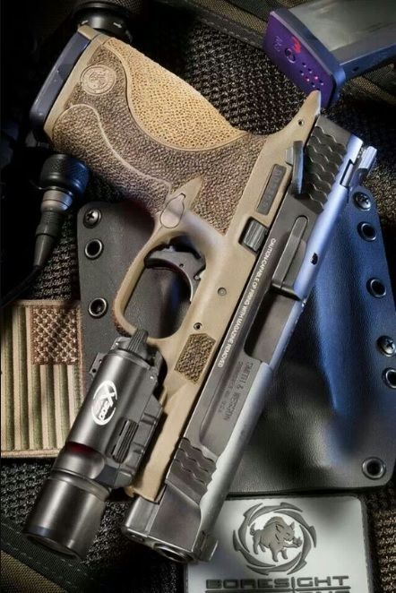 Smith and Wesson M&P45 semi-automatic pistol in dark earth brown with SureFire X300 weapon light.