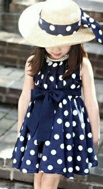 Gorgeous Navy Blue dress with White Polka Dots  I sooo want this for Michaela!!!!!!!!!