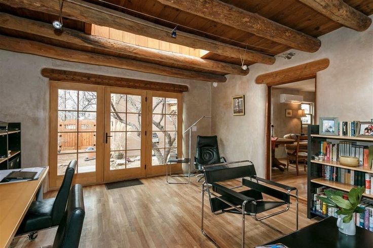 You Ll Love The Light Bright Interior Of This Santa Fe Pueblo Adobe Home The Modest Mansion Adobe House Home Southwest House