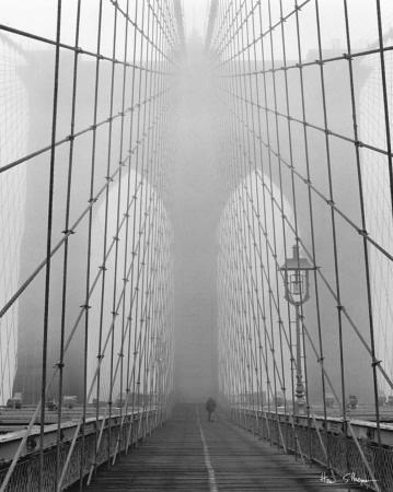 Walking on a foggy day on the Brooklyn Bridge