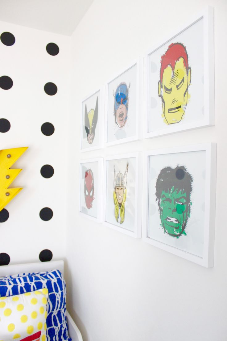 Yesss to this cool superhero art for a big boy room!