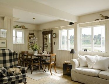 SUFFOLK: Boutique B & B in Woodbridge from www.uniquehomestays.com.  Love the smart, nautical look softened by grey-blues and white-washed panelling.  Giant check textile and dark wood furniture make it more captain's quarters than coastal cabin.  Look out for View Two . . .