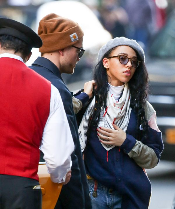 Woah -- FKA Twiggs was spotted wearing a ring on the fourth finger of the left hand! Could this mean she and Rob Pattinson are engaged or possibly already married? Check out the pic! Robert Pattins...