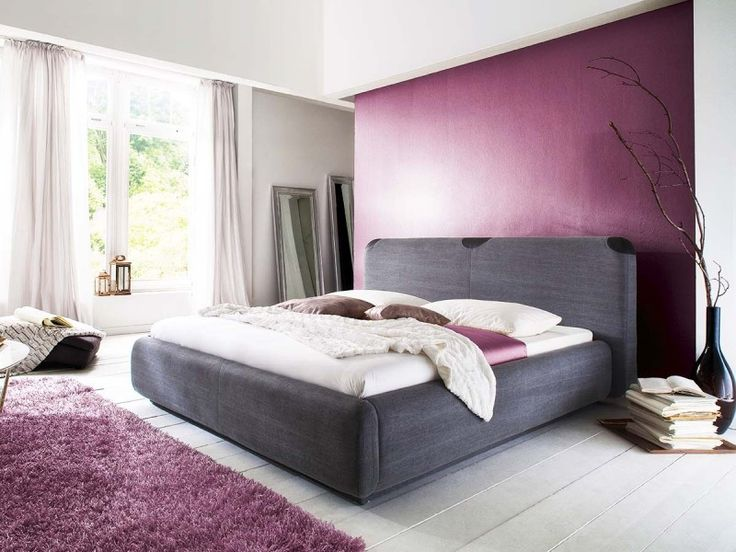 This stylish bed with an unusual headboard is the perfect blend of fashion and comfort.