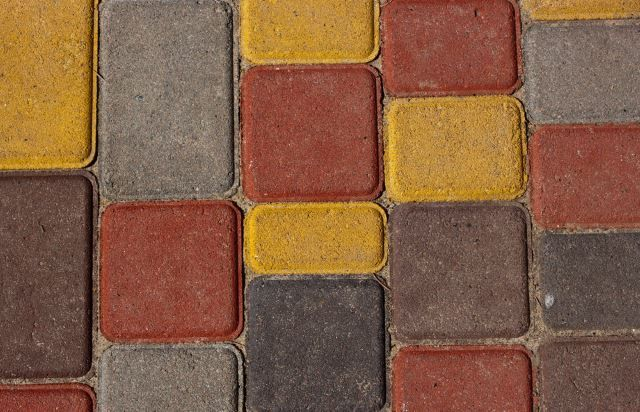 These super cute flat, square bricks are various colors and will add so much character to an outdoor area. Whether it's under a gazebo, under a garden birdbath or placed as an entire outdoor patio, these bricks demonstrate how easy it is to incorporate color and add so much depth to an area. This is only one color scheme out of thousands you can choose from. You just need to determine what the color scheme is and how large the space is that you need paving.