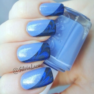 Water marble diagonal tips! Essie Pure Pearlfection over Lapis of Luxury. China Glaze Concrete Catwalk and Eyes Like Sapphires for the marble accents.