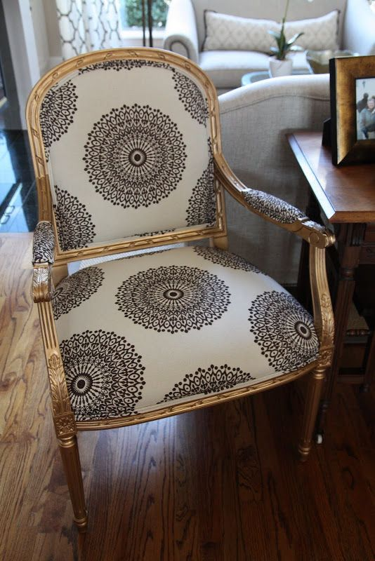 reupholstered chair: medallions/ gold paint