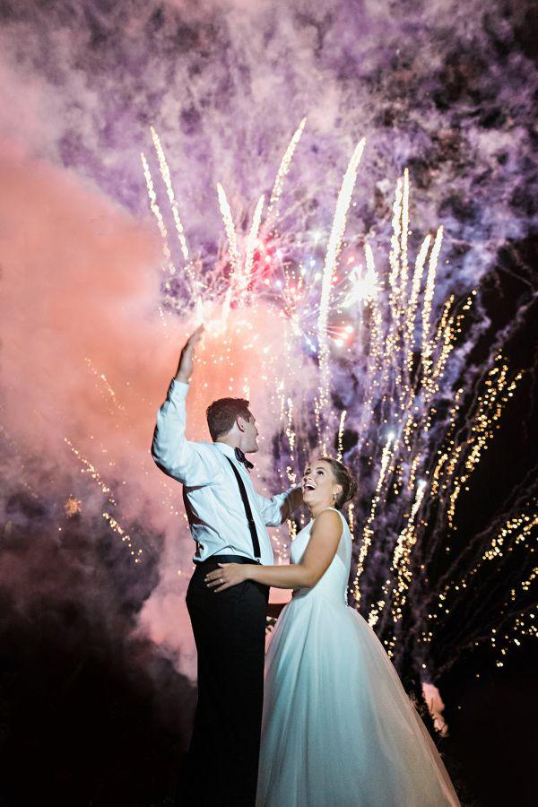 Stunning fireworks moment: http://www.stylemepretty.com/canada-weddings/2016/02/19/elegant-windswept-oceanside-wedding/ | Photography: Candace Berry - http://candaceberry.com/