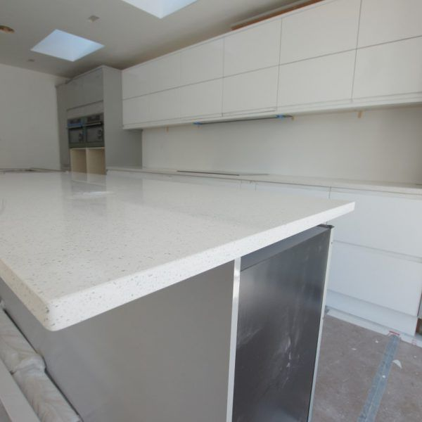 A very large kitchen island is featured in this kitchen with the simply stunning breakfast bar on the other side that is big enough to host a party on. It has been finished with the Bianco Stella on top.