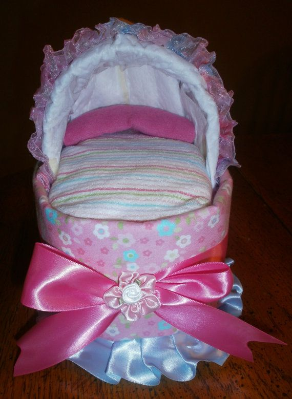 Clothesline baby shower theme 10 handpicked ideas to for Diaper crafts for baby shower